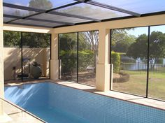 Pool screened in with roof and walls, fitted into existing structure. (Don't dive in yet! Screened Pool, Pool Enclosures, Diy Pool, Swimming Pools, Windows, Outdoor Decor, Pool Ideas, Walls, Home Decor