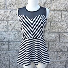 Stripe Chevron Peplum Top Fun top! Condition: Previously loved... Worn once! Flaws: None. Tops