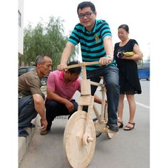 """A Chinese man from Kaiyuan in northeast China's Liaoning Province has created a bicycle using more than 10,000 ice lolly sticks. Sun Chao finished his popsicle stick bike after four months of hard work. The 25kg bike is 1.5m long, 0.55m wide and 0.95m high. Sun said: """"It didn't disappoint me. I am 90kg and the bike could take me without a problem."""""""
