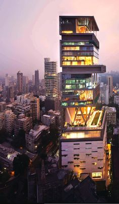 """Antilia"" in Mumbai, India is the most expensive private residence in the world. It's the first of its kind- a skyscraper mansion worth an estimated $1.5 billion. It sits near of one the poorest most crowded slums in the world. (xpost r/evilbuildings)"