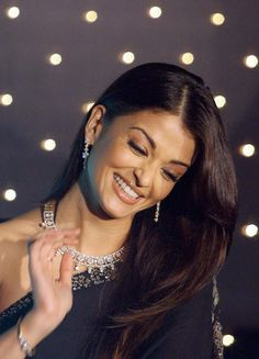 Former Miss World and Indian film actress Aishwarya Rai reacts at a press conference to launch a new Nakshatra collection of diamond jewellery from Diamond Trading Corporation (DTC) in Mumbai on Oct. 3, 2006.