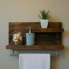 Bathroom Wood Shelf This DIY bathroom shelve is easy to create, really eye-catching, small enough to easily fit any bathroom wall space, and packs a lot of charm.
