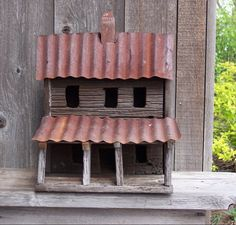 Two-Story Birdhouse Cabin with tin roof. more use for my rusted tin. maybe 1 opening and black blanks to represent windows. like chimney