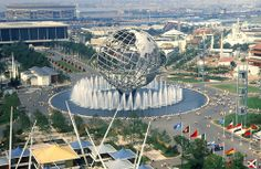Flushing NY, World's Fair 1964 -- and look: the old Shea Stadium is in the background I think!  Upper left.    === New_York_World%27s_Fair_August_1964.jpeg
