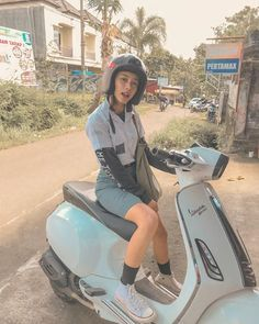 Cute Indonesia school girl with motorcycle