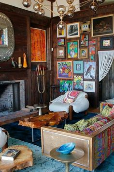 love the overcrowded arrangement of wall art.  and the colors!!!