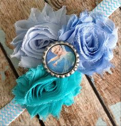 Hey, I found this really awesome Etsy listing at http://www.etsy.com/listing/172210609/disneys-frozen-elsa-shabby-flower