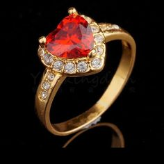 18K Yellow Gold Filled Red Heart with Accents Ring - Size 9   Exquisite 18K Gold Filled Red Heart Ring with Accents.  This ring can be worn for special occasions or worn to work.  It's gorgeous in a stylish setting.  Would make a great gift for that special friend or family member.