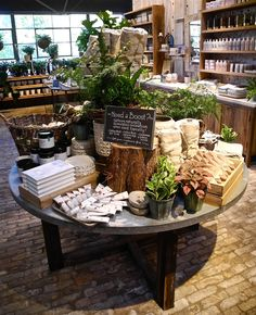 Beautiful natural appeal in this inshore display. Even down to the brick flooring. Terrain Shop in Westport, Connecticut Design Shop, Deco Cafe, Retail Merchandising, Retail Store Displays, Gift Shop Displays, Merchandising Ideas, Market Displays, Flower Shop Displays, Display Shop
