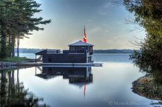 one of Lake Rosseau's most unique boathouses, and the original Thorel House site courtesy of cottageblog.ca
