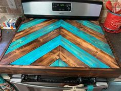 Handmade wood chevron stove cover can do other colors as well. Made out of white pine and Baltic birch Gas Stove Top Covers, Wooden Stove Top Covers, Diy Wooden Projects, Wooden Diy, Home Projects, Home Decor Kitchen, Diy Home Decor, Stove Board, Diy Holz