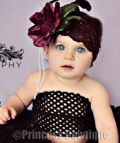 She's a cutie in this flapper girl hat.