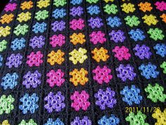 handmade granny square afghan  throw  blanket  bright colors yarn crochet. $200.00, via Etsy.