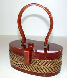 What a lovely bakelite hand bag! Brass grillwork accents.Signed Wilardy.