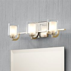 Brighten your bathroom with this modern steel and glass fixture by Quoizel Kolt.