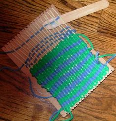 Cardboard loom using either popsickle sticks or rulers. I would use two; one to weave through the strings then stand it on its side so the other stick with the thread goes through easily...
