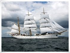 """The """"Gorch Fock"""" is a famous tall training ship of the German Navy (Deutsche Marine). She is the second ship of that name and a sister ship of the Gorch Fock built in 1933. Both ships are named in honor of the German writer Johann Kinau who wrote under the pseudonym Gorch Fock and died in the battle of Jutland/ Skagerrak in 1916. The modern-day Gorch Fock was built in 1958 and has since then undertaken 146 cruises (as of October 2006), including one tour around the world in 1988."""