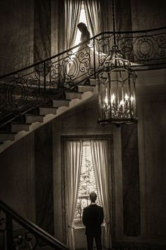 Susan Stripling shares her work as one of the world's best wedding photographers. Here a bride descends the stairs where her groom awaits. Inspiring photography. Click for more images from the world's best wedding photographers. #quotesforbrideandgroom #weddingplanningcheatsheet