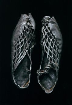 A pair of intricately cut shoes that were found on a bog body from over 2,300 years ago