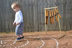 So much to love in this one image -- a backyard labyrinth? A sensory garden?  A wooden wind chime?  Swoon.    A wind chime instrument for our sensory garden
