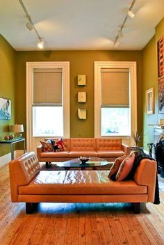 Again with the orange and green.  The linen color of the shades plays nicely with the cream trim.