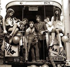 The Who on the 'Magic Bus' with some girls and a baby elephant, 1968