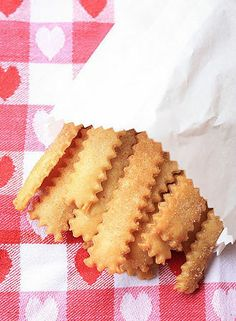 "Pie fries  Pie Fries:  Cut pie crust (or pie crust scraps) into strips with a fluted pastry wheel.    Brush with melted butter.  Sprinkle with cinnamon and suger.  Bake at 375 degrees for about 15 minutes.  Eat ""as is"" or dip into jam, pie filling or frosting:)"