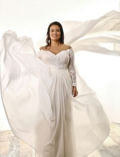 Plus size lace off the shoulder sleeves wedding gown with chiffone overskirt. Lida. Studio Levana