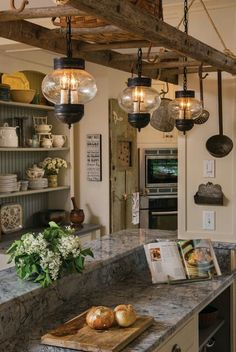 I adore lantern style hanging lights especially in the kitchen. I like a more modern look in the kitchen so the lanterns give a bit of vintage twist that finishes the space.