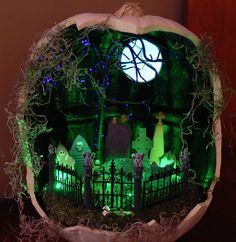 Halloween decor craft. Memory Pumpkin.  Using a craft pumpkin I cut the front out and painted the inside black.  Taking pictures of the tombstones that are used in our yard at Halloween transfered onto shrinky dinks.  Add some Lemaxx accessories and lights and voila, I created my front yard. Halloween Diorama, Halloween Scene, Halloween 2017, Halloween Crafts, Halloween Decorations, Halloween Fairy, Halloween Village, Halloween Pumpkins, Holidays Halloween