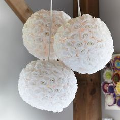 easy diy - paper lantern, hot glue gun silk flowers. cut off the stem glue the bud. any color/type of flower
