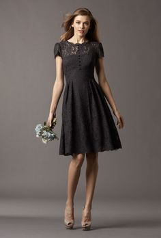 """Brides.com: Bridesmaid Dresses with Sleeves. Style 4257, """"Ash"""" charcoal lace crewneck bridesmaid dress with an illusion neckline, $306, Watters  See more Watters bridesmaid dresses."""