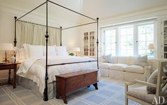 i love tall bed frames that seem they are for a canopy but are empty (great use of curtains as a headboard in this one though)