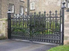 Elegant wrought-iron gate Heavy duty scroll design, Victorian wrought iron gate. Decorative fence post capitols