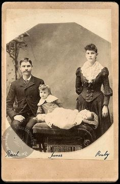 conjoined twins with their mother and father