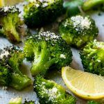This parmesan roasted broccoli is seasoned with olive oil, parmesan and herbs. Put it in a hot oven and cook until tender and browned for the best broccoli you'll ever have!
