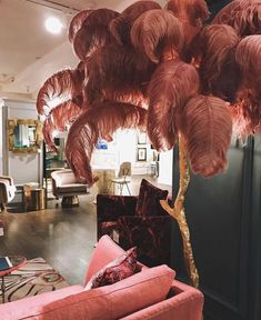 Proud as punch (pink) // Great picture taken in @harrods of one of our Ostrich feather lamps! available at amoderngrandtour.com #aynhoepark