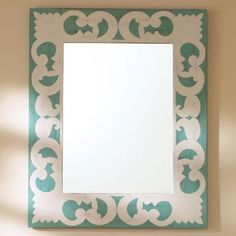The cutout scroll design on this mirror would work perfectly in many settings: a beach cottage, little girl's room or even in a bathroom.