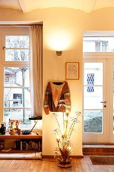 Stephen Landwehr's Home in Berlin. Tip: Handing up a favorite article of clothing makes a great room accessory. Very human space.