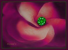 Rare Russian Demantoid Garnet, over 1 carat. Stunning brilliancy and vivid green color.