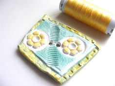 Handcrafted Ceramic Button turquoise yellow by pushingbuttons