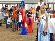 Participants face the judges during the llama costume