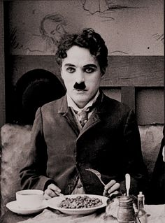 """Charlie Chaplin in one of his greatest films - Mutual's """"The Immigrant"""" 1917. Food was a very important element in this."""