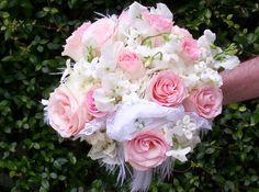 Beautiful feminine nosegay of pink esperance roses, white sweetpea, white hydrangeas and stephanotis.
