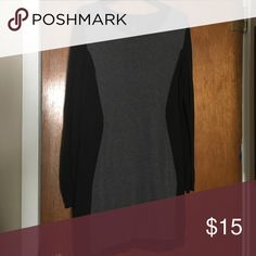 🍀SALE! Black and gray sweater dress Black and gray sweater dress. The hourglass design on this dress creates a very sliming silhouette. Good condition. Dresses
