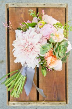 Dahlia and succulent bouquet {Photo by Kate Osborne via Project Wedding}