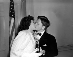 Judy Garland receives a congratulatory kiss from frequent co-star Mickey Rooney as she is given a special Academy Juvenile Award at the Oscars on Feb. 29, 1940.
