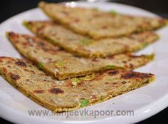 Paranthas stuffed with green pea and cottage cheese mixture.
