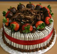 """8"""" $28, 9"""" $32 Chocolate covered strawberries with chocolate drizzle and chocolate shavings with red ribbon around the side."""