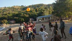 Kids chasing a balloon at Chikale Beach, Nkhata Bay